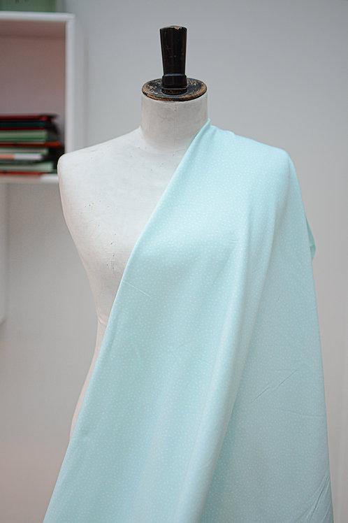 Tricot blauw met witte stippen