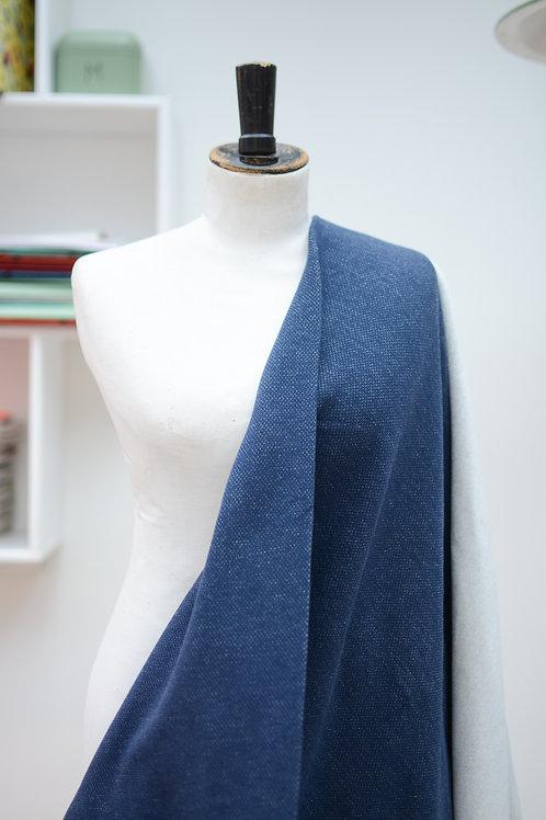 Jogging geruwd blauw uni textuur jeanslook.