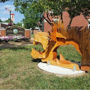 City Of Manassas Town Hall, Lion amongst men sculpture (SOLD)