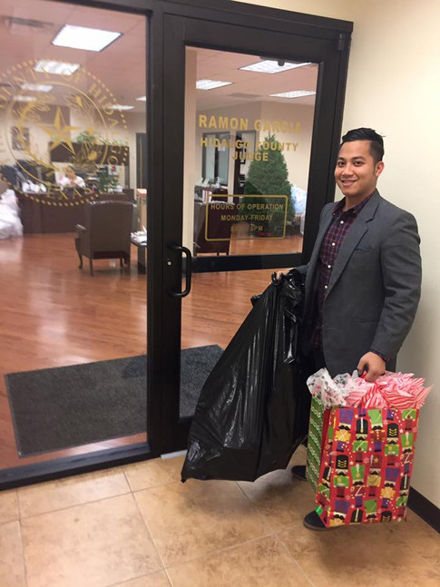 Ben Abila Delivering Donated Gifts