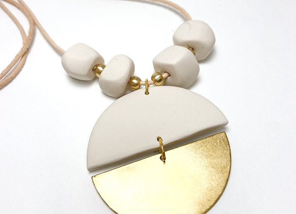 Pebble cream and brass rope necklace
