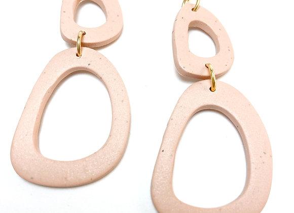 Irregular shaped pink dangles