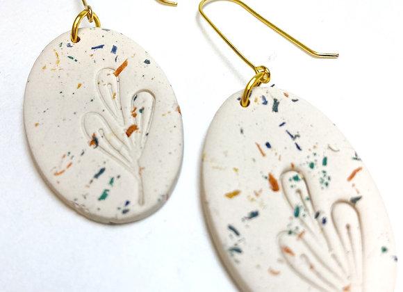 Beige speckled oval hook earring
