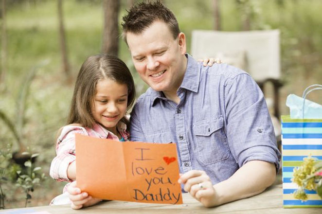 Father-excitedly-receives-a-homemade-card-from-his-daughter.jpg