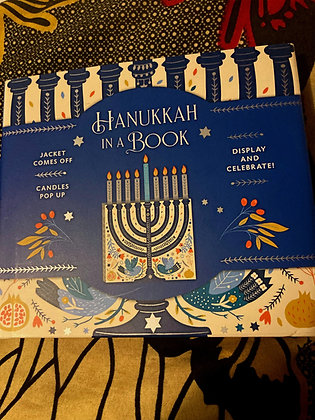 Hanukkah in a Book : Jacket comes off. Candles pop up.