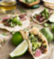 A Steak Taco and Limes.