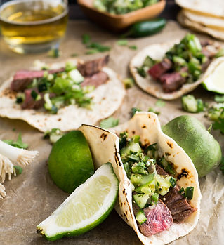 A Steak Taco and Limes.