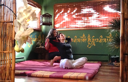 tess and client doing a heart opener thai massage posture