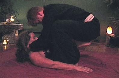 tess and a client doing a partner yoga posture called yin an yang beneficial for spine and neck