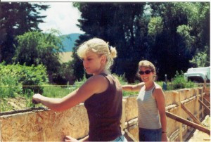 Kristi and Penny setting foundations in the early stages of construction