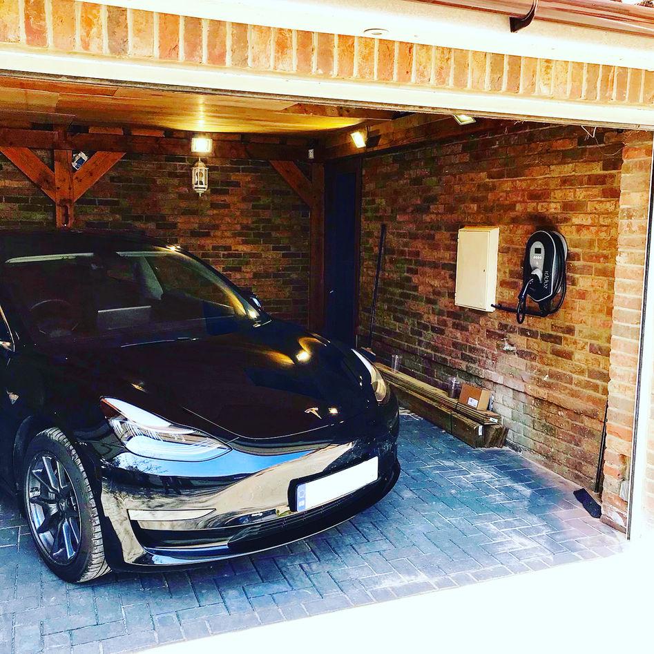 Zappi v2 black tethered in garage