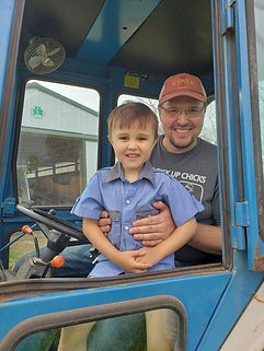 Ryan in Tractor with Nephew.jpg