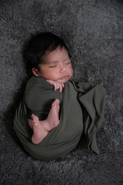 Baby boy wrapped sleeping