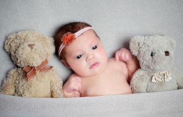 Baby girl and teddy photo