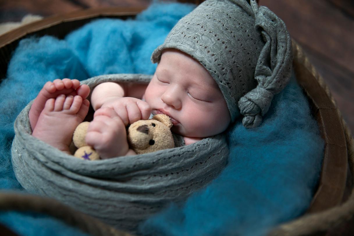 Baby in wooden bucket