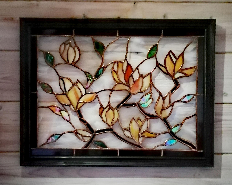 Magnolia framed wall panel. Spectrun white whisp, irridised green and whissmach mottled orange. Pane
