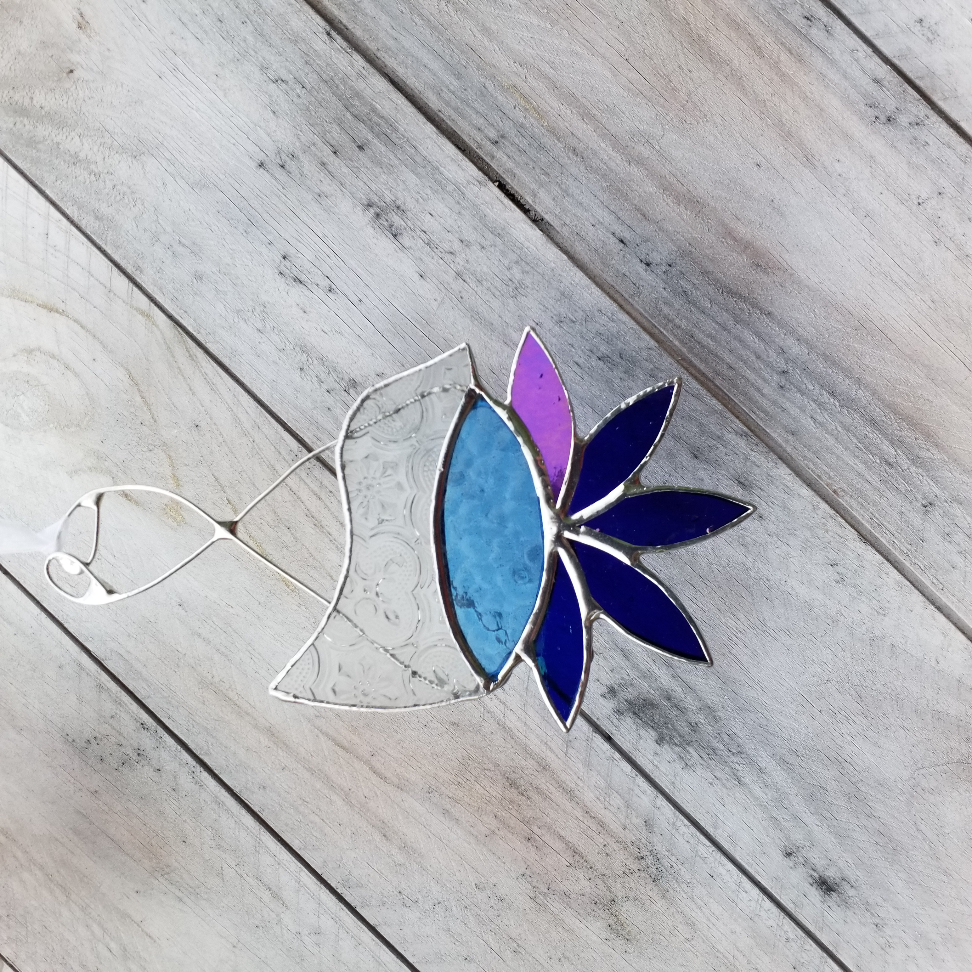Small blue bird with clear textured glas