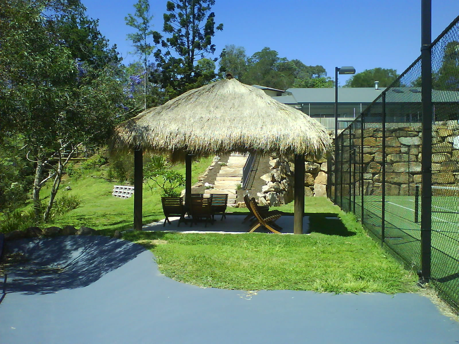 Tennis courts roofs - Bali huts