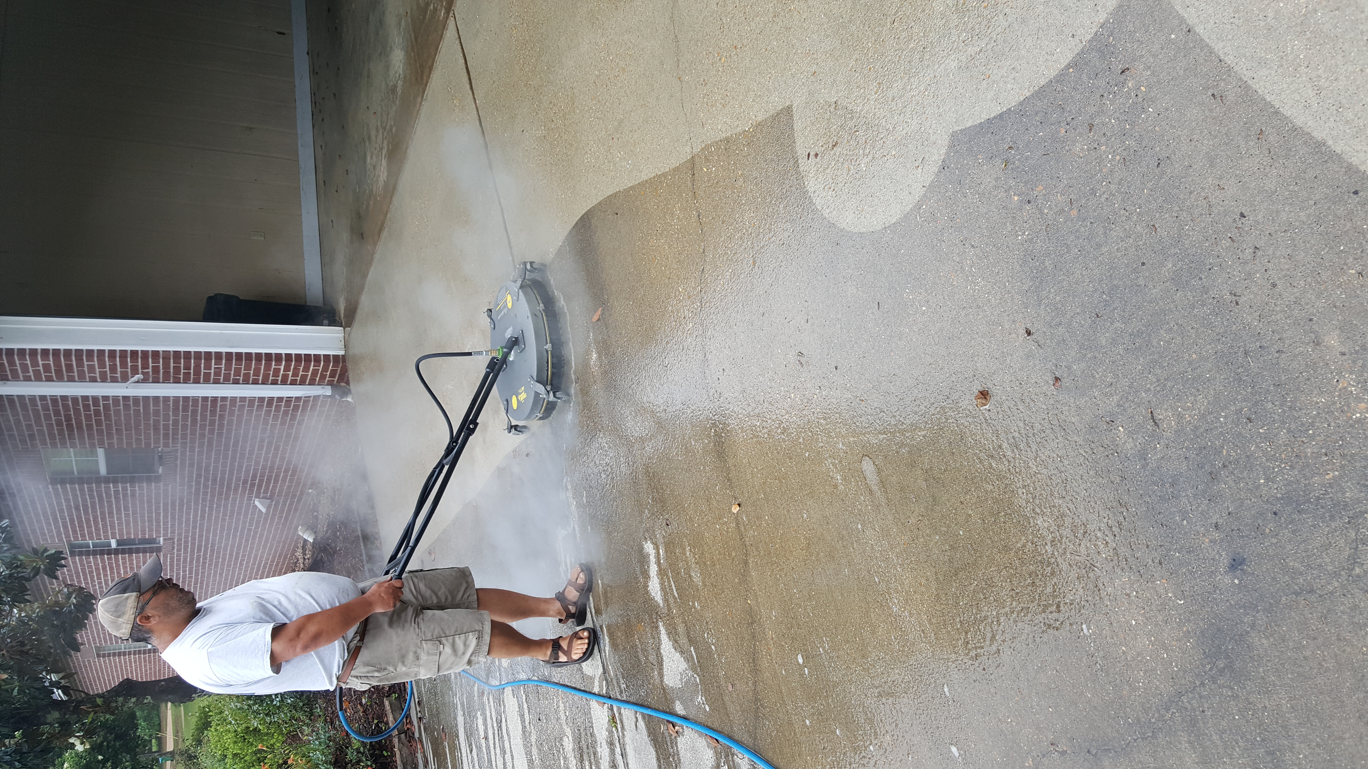 Hot water concrete cleaning