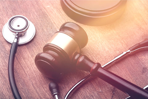 Gavel and stethoscope on a wooden surface._edited.jpg