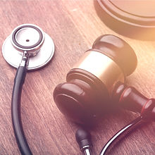 Gavel and stethoscope on a wooden surface_edited.jpg