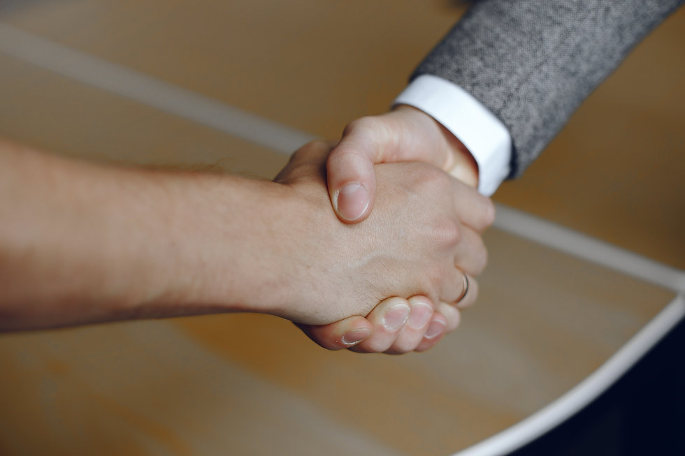 close-up-image-firm-handshake-man-standi