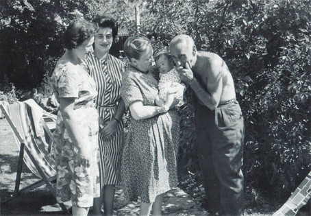Vera's mother Rose, Vera, Peter's mother holding Michael, and Vera's father Stephen