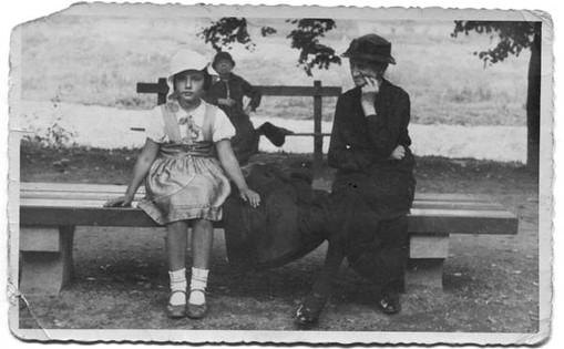 Sitting in Bielsko Park with grandmother Zofia, 1935