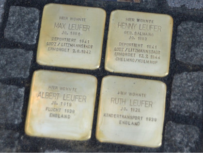 Stolpersteine representing Ruth, her parents and her brother sunken into the pavement outside her family home