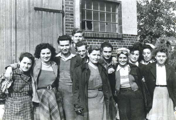 Outside the barracks in Bergen 1945. Eva is 2nd on the left. Camp sister Pinick is on left