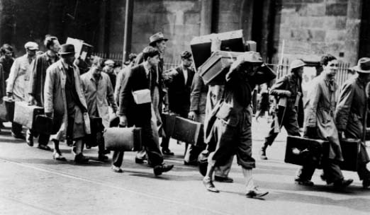 Refugees classed as 'enemy aliens' being marched to internment camps, summer 1940