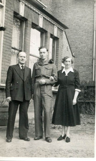 George in military uniform with his parents, 1952
