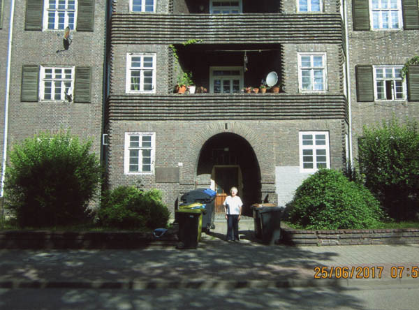 Hanna outside their old apartment building in Erfurt. They lived on the first floor, centre apartment.