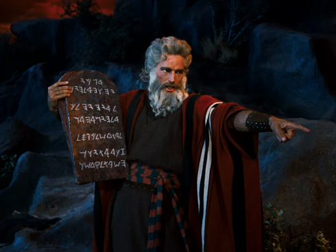 Charleton Heston as Moses getting the 10 Commandments from the top of Mount Sinai