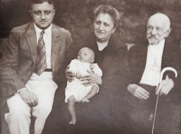 Rudi is being held by his paternal grandmother, Bertha who is sitting alongside his father and great-grandfather, Louis Marcus in Berlin, 1926