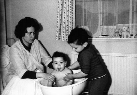 Michael bathing Paul