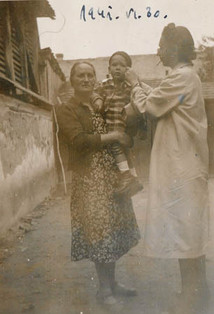 Ivan being held by Erzsi (left) and with this mother