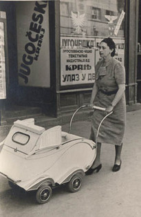 Ivan's mother pushing his pram, April 1939