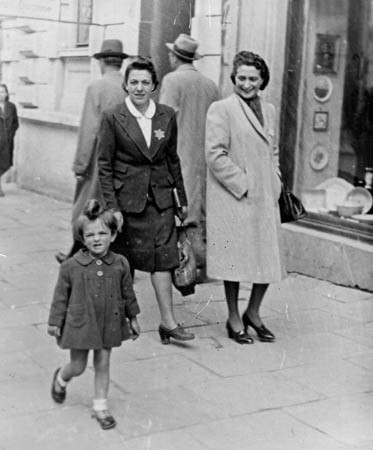 At about 2 years old with mother (centre) & Selma