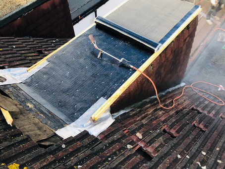 A recent small flat roof and chimney pot repair
