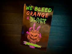 Find Chilling Short Stories in We Bleed Orange & Black