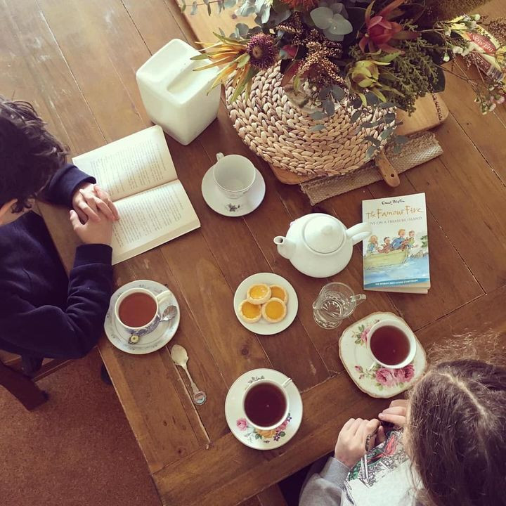 children sitting enjoying teatime and a read aloud story