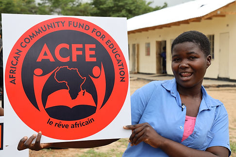 An ACFE Student holds a banner in celebration of her scholarship opportunity at Musena in Zimbabwe
