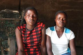 Elizabeth Bandera and Joanah Mapisa at their rural home in Musena, Zimbabwe.