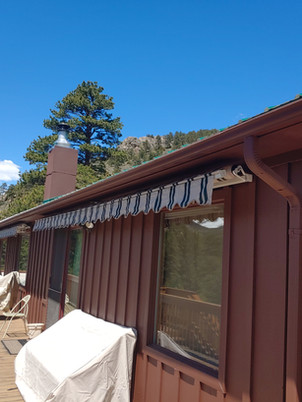 Awning under roof