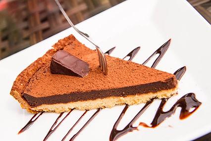 Chocolate Truffle Filled Tart Dusted wit