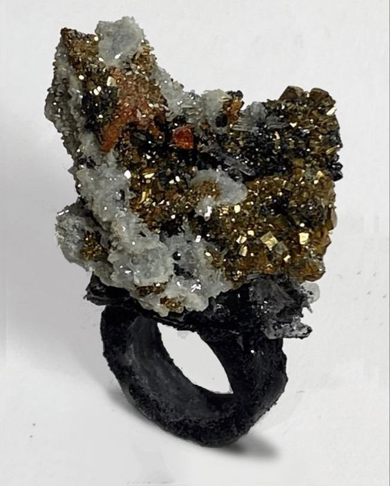 calcite, pyrite, resin composite ring.  for sizes and availability, please message me at  osianefnisien@hotmail.co.uk