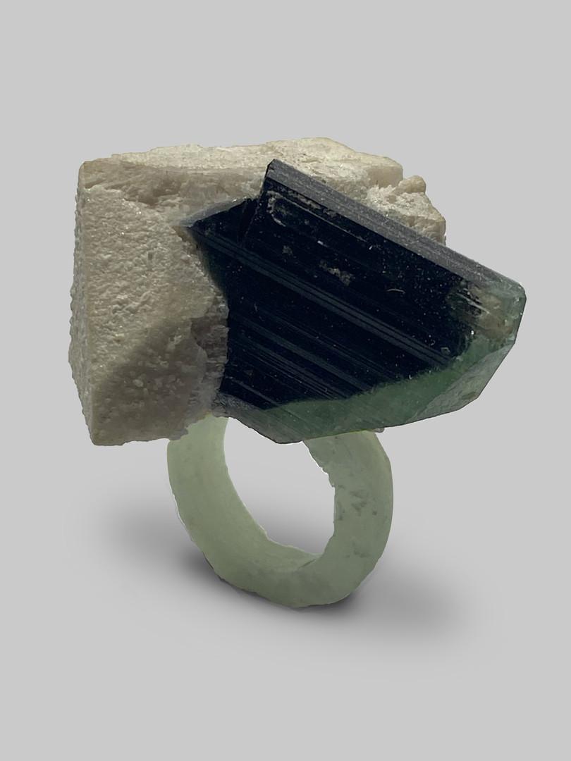 """tourmaline, felspar and paper/resin composite ring on a lighter ring.  modrwydd tormalin a felspar ar resin ac ffapur.  am fwy o wybodaeth cysylltwch a """"osianefnisien@hotmail.co.uk"""""""