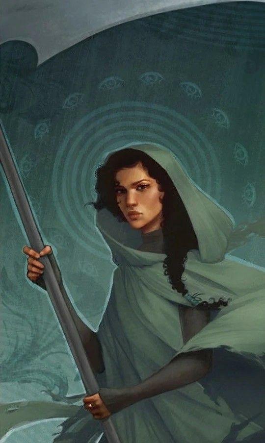 A imagem mostra uma jovem negra, com cabelos crespos e pretos, vestindo um manto esverdeado sobre um fundo também verde. Ela está segurando algo que parece ser uma foice. A jovem representa a ceifadora Anastacia.
