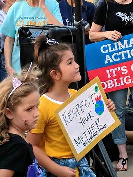 little girl w sign.jpg